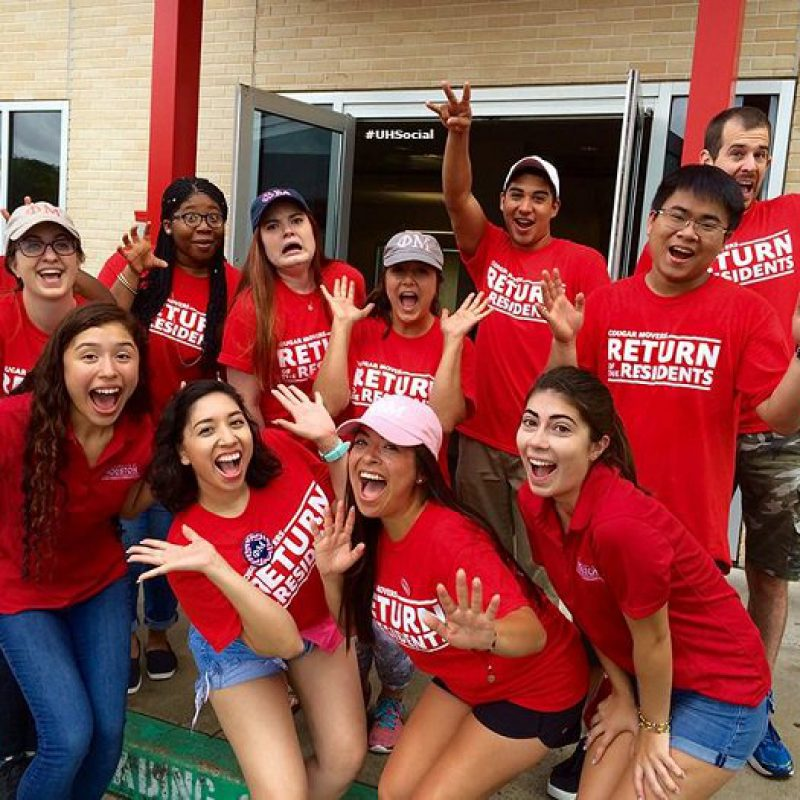 Students Posing in University of Houston Resident Shirts
