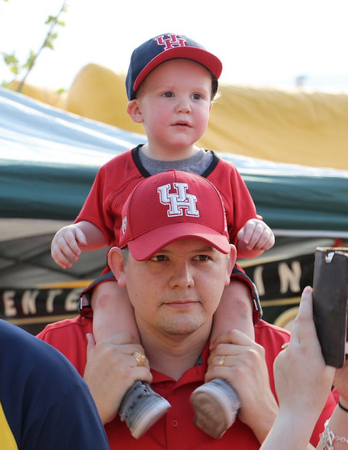 Father and Infant Wearing University of Houston Caps